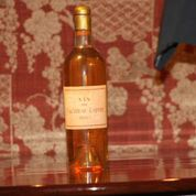 Lafite Blanc bottle with wine